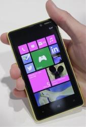 Nokia's smartphone, the Lumia 820, equipped with Microsoft Windows Phone 8, is displayed.