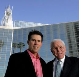 Robert A. Schuller, left, poses for a photo with his father, Robert H. Schuller, outside the Crystal Cathedral  Feb. 9, 2006, in Orange, Calif.