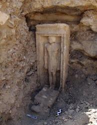 This image released by Egypt's Supreme Council of Antiquities shows a recently discovered statue in a complex of tombs, including one of a pharaonic princess, south of Cairo.
