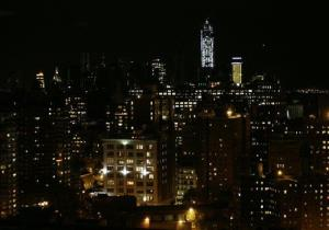 In this photo looking south from 33rd Street in New York City, lights are on  in some buildings in Lower Manhattan as power gradually returns to parts of the city, Friday, Nov. 2, 2012.