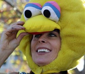 Mary Beth Griffith wears a Big Bird head piece in this Oct. 11, 2012, in Danville, Ky.