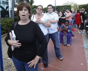 Diana Camacho, left, chants we want to vote, after the elections office in Miami-Dade County closed its doors to voters who waited in long lines for an absentee ballot.