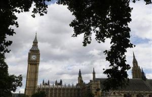 The 315-foot-high clock tower which houses the Big Ben bell is framed by a tree on Parliament Square opposite the Palace of Westminster, London, Wednesday, Sept. 12, 2012.
