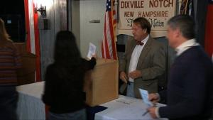 Dixville Notch voters drop their ballots in the ballot box as they cast the first Election Day votes in the nation.