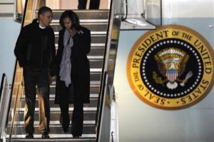 President Barack Obama and first lady Michelle Obama walk off Air Force One after arriving at O'Hare International Airport in Chicago, Tuesday, Nov. 6, 2012.
