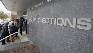 Voters enter the Cuyahoga County Board of Elections in Cleveland on the last day of early voting in Ohio Monday, Nov. 5, 2012. About 1.6 million people have voted early in Ohio.