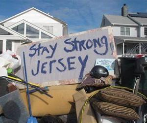 Residents of a flood-wrecked home in Point Pleasant Beach NJ offer encouragement to fellow victims of Superstorm Sandy, Nov. 5, 2012, in this message scrawled on the bottom of a waterlogged mattress.