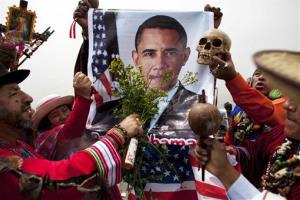 Peruvian shamans bless President Barack Obama using a poster of him during a ritual to predict the winner of the presidential election in Lima, Peru, Monday, Nov. 5, 2012.