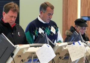 Speaker John Boehner, R-Ohio, center, votes at Ronald Reagan Lodge Tuesday in West Chester, Ohio.