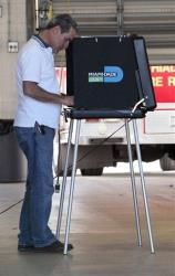 A man casts his vote at Hialeah Fire Station No. 5 in Hialeah, Fla. on Election Day Tuesday, Nov. 6, 2012.