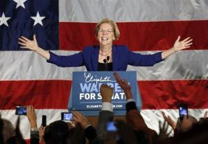 Democrat Elizabeth Warren takes the stage after defeating incumbent GOP Sen. Scott Brown.