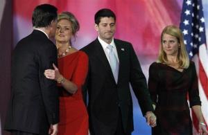 Mitt Romney, embraces his wife Ann as Paul Ryan and his wife Janna walk onstage at left at Romney's election night rally in Boston.