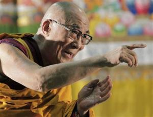 Tibetan spiritual leader the Dalai Lama gestures to devotees as he arrives to give a religious talk in Yokohama, near Tokyo, Sunday, Nov. 4, 2012.