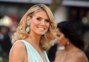 This Sept. 23, 2012 file photo shows model and host of Project Runway, Heidi Klum arriving at the 64th Primetime Emmy Awards at the Nokia Theatre in Los Angeles.