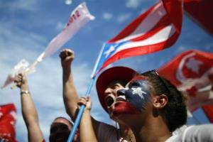 Supporters of Alejandro Garcia Padilla, candidate for governor of the pro-commonwealth Popular Democratic Party, cheer during his closing campaign rally in San Juan, Puerto Rico, Sunday, Nov. 4, 2012. P