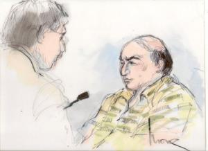 This Sept. 27 courtroom sketch shows shows Mark Basseley Youssef talking with his attorney Steven Seiden.