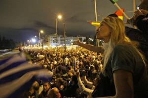 A protester shouts anti-government slogans during a demonstration outside the parliament in Athens, Wednesday Nov. 7, 2012.