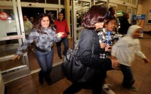 Shoppers rush into an Oakland, Calif., Wal-Mart as the store opens its doors at 5 am on Friday, Nov. 28, 2008.
