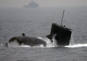 A Japanese Maritime Self-Defense Force (JMSDF) submarine Wakashio surfaces off the water during a fleet review off Sagami Bay, south of Tokyo, Japan, Sunday, Oct. 14, 2012.