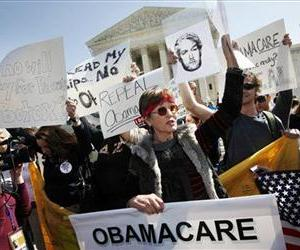 Protesters who identified themselves as being with the Tea Party Patriots, demonstrate against the health care law outside of the Supreme Court, March 26, 2012.