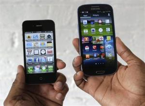 The Apple iPhone 4s, left, is displayed next to the Samsung Galaxy S III at a store in San Francisco, Monday, Aug. 27, 2012. Apple Inc. on Monday submitted a list of eight Samsung Electronics Co. products it wants pulled from shelves and banned from the U.S. market. Apple...