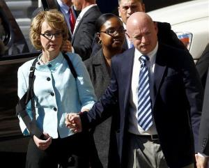 Gabrielle Giffords and husband Mark Kelly leave after the sentencing of Jared Loughner in Tucson, Ariz.