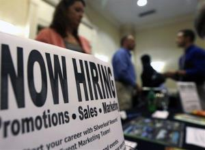 In this Oct. 25 photo, a sign attracts job-seekers during a job fair at the Marriott Hotel in Colonie, N.Y.