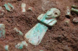 This photo taken on May 25, 2012 shows a jade piece in the tomb of a very early Mayan ruler.