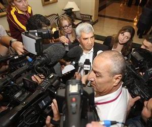 Syrian dissident Riad Seif, center, speaks to the media at the meeting of the General Assembly of the Syrian National Council in Doha, Qatar, Thursday, Nov. 8, 2012.