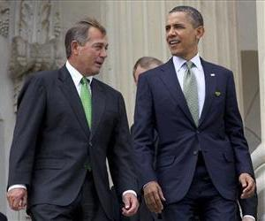 John Boehner and Barack Obama walk down the steps of the Capitol in this March 20, 2012 file photo.