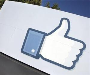 A Jan. 12, 2012 file photo, shows the Facebook like icon displayed outside of Facebook's headquarters in Menlo Park, Calif.