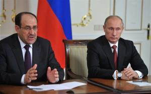 Russia's President Vladimir Putin, right, and Iraqi Prime Minister Nouri al-Maliki speak to the media after a meeting in Moscow on Oct. 10.