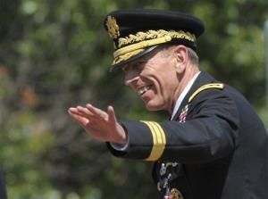 Davis Petraeus waves after an armed forces farewell tribute and retirement ceremony at Joint Base Myer-Henderson Hall in Arlington, Va., Wednesday, Aug. 31, 2011.