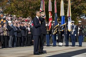 President Obama pays his respect at the Tomb of the Unknowns at Arlington National Cemetery during a Veterans Day ceremony, Sunday, Nov. 11, 2012. At right, Maj. Gen. Michael Linnington.