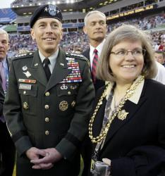 In this Feb. 1, 2009 file photo, Gen. David Petraeus stands with his wife Holly before the NFL Super Bowl XLIII football game in Tampa, Fla.