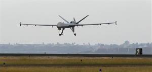This Nov. 8, 2011, file photo shows a Predator B unmanned aircraft landing after a mission, at the Naval Air Station, in Corpus Christi, Texas.
