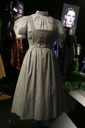 This  blue-and-white gingham pinafore dress worn by Judy Garland in  The Wizard Of Oz, sold for $480,000.