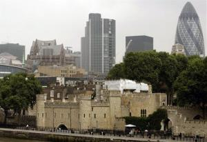 This Tuesday June 12, 2007 file photo shows the Tower of London, foreground, surrounded by modern buildings in London.