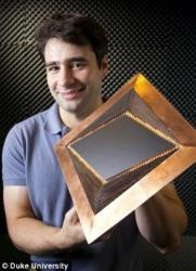 Nathan Landy at Duke University holds up their new invisibility cloak.