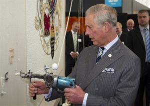 Britain's Prince Charles attempts to do some tufting during his visit to the New Zealand Shear Brilliance Event, in Auckland, New Zealand, Monday, Nov. 12, 2012.