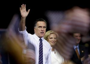 Mitt Romney, accompanied by wife Ann, waves after speaking at a campaign event at George Mason University on Nov. 5.