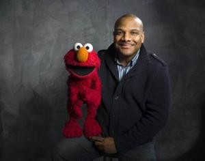This Jan. 24, 2011, photo shows Sesame Street muppet Elmo and puppeteer Kevin Clash.