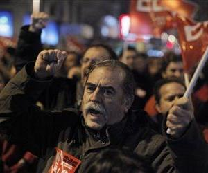 A protester shouts slogans during a general strike in Madrid, Spain, Wednesday, Nov. 14, 2012.