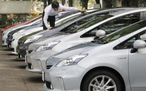 An employee of Toyota Motor Corp. cleans a Prius in Tokyo Friday, May 13, 2011.