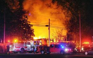 Flames and smoke billow from a home in west Jackson, Miss., Tuesday evening, Nov. 13, 2012, after authorities say a small plane carrying three people crashed into the residence shortly after 5 p.m.