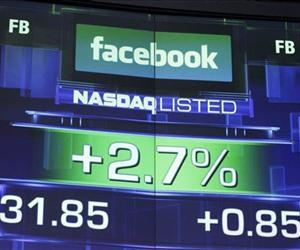 This Wednesday, May 23, 2012, file photo, shows the pre-market price for Facebook at the Nasdaq MarketSite in New York.