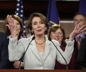 Nancy Pelosi gestures during a news conference on Capitol Hill, Tuesday, Nov. 13, 2102,  with newly elected Democratic House members.