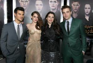 From left, Taylor Lautner, Kristen Stewart, Stephenie Meyer, and Robert Pattinson attend the world premiere of The Twilight Saga: Breaking Dawn Part II at the Nokia Theatre on Monday, Nov. 12, 2012, in Los Angeles.