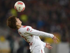 Stuttgart's Gotoku Sakai  heads the ball  during a German soccer match in Stuttgart, southern Germany, Sunday Nov. 11, 2012.