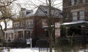 In this Dec. 10, 2009, file photo in Chicago, the home belonging to President Barack Obama and family, left, is pictured.